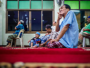 16 MAY 2018 - BANGKOK, THAILAND: Men gather for evening prayers on the first night of Ramadan at Masjid (Mosque) Darul Falah, a small mosque in Baankrua, the oldest Muslim neighborhood in Bangkok. Based on the sighting of the new moon, Ramadan fasting starts on Thursday, 17 May in Thailand.      PHOTO BY JACK KURTZ