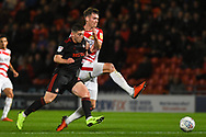 Joe Wright of Doncaster Rovers (5) clears the ball under pressure from Lynden Gooch of Sunderland (11) during the EFL Sky Bet League 1 match between Doncaster Rovers and Sunderland at the Keepmoat Stadium, Doncaster, England on 23 October 2018.