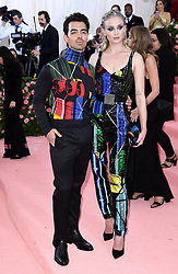 """Sophie Turner and Joe Jonas at the 2019 Costume Institute Benefit Gala celebrating the opening of """"Camp: Notes on Fashion"""".<br />(The Metropolitan Museum of Art, NYC)"""