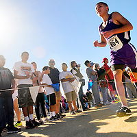110913  Adron Gardner/Independent<br /> <br /> Miyamura Patriot Niles Thomas rounds a corner during the State cross country meet at Rio Rancho High School in Rio Rancho Saturday. Thomas placed third in the boys 4A race with a time of 16:00.50.