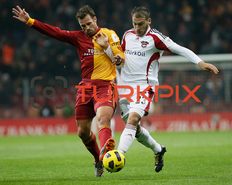 Galatasaray's Lucas NEILL (L) and Gaziantepspor's Cenk TOSUN (R) during their Turkey Cup Quarter final matchday 2 Galatasaray between Gasiantepspor at the AliSamiYen Turk Telekom Arena in Istanbul Turkey on Wednesday 02 March 2011. Photo by TURKPIX