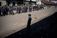 A  minor migant is seen observing a line for a food distribution in Belgrade train station makeshift camp. Belgrade, Serbia. March 17th, 2017. Federico Scoppa