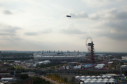 © Licensed to London News Pictures. 12/08/2012. LONDON, UK. The Olympic Stadium, ArcelorMittal Orbit and Goodyear Blimp are seen ahead of the the closing ceremony of the 2012 Summer Olympics is seen in London today (12/08/12). The Games of the 30th Olympiad today come to a close in London after two weeks of athletics and sports competition carried out by 204 countries from around the world. Photo credit: Matt Cetti-Roberts/LNP