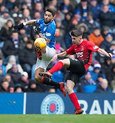 Rangers' Daniel Candeias and Kilmarnock's Greg Taylor battle for the ball during the Ladbrokes Scottish Premiership match at Ibrox Stadium, Glasgow.