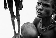 AJIEP, SUDAN-JULY 1998:<br /> A Dinka mother and her starving children wait silently for food at the Medecins Sans Frontieres feeding centre in Ajiep, southern Sudan, during the 1998 famine.<br /> (Photo By Tom Stoddart/Getty Images)