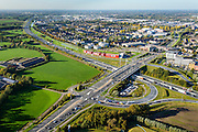 Nederland, Gelderland, Ede, 24-10-2013. Autosnelweg A12, afslag Ede. Bioskoop CineMec Ede in de geluidswal.<br /> Motorway A12 near Ede, film theatre in the noise barrier.<br /> luchtfoto (toeslag op standaard tarieven);<br /> aerial photo (additional fee required);<br /> copyright foto/photo Siebe Swart.