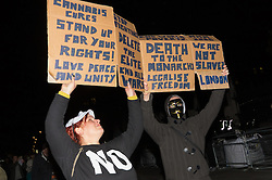 London, November 5th 2016. Anti-capitalists and anarchists participate in the Million Mask March, an annual event that happens on November 5th each year in cities across the world, as part of a protest against the establishment. Many of the protesters wear Guy Fawkes masks, often associated with the internet activism group Anonymous. PICTURED: Multiple messages appear on a single placard held up by masked protesters.