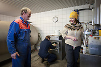 Geologist bottling water samples from rivers and small streams near Þorvaldseyri. They are allowed to do their work inside the milk-house at the farm.