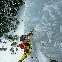 """ICE CLIMBING. Alex Lowe repeats his first ascent of """"Come & Get It,"""" a hanging ice needle in Hyalite Canyon, in Gallatin Mountains near Bozeman, Montana"""