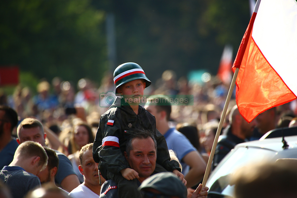 August 1, 2018 - Warsaw, Poland - Celebrations on 74th anniversary of Warsaw Uprising in the center of Polish capitol. Masses of participants show flags and flare fires to remember of the city fighters of 1944 during World War II. (Credit Image: © Madeleine Lenz/Pacific Press via ZUMA Wire)