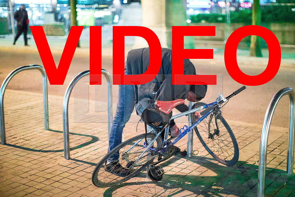 VIDEO available here: https://we.tl/zvcu9ewaJi<br /> <br /> © Licensed to London News Pictures . 07/04/2017 . Manchester , UK . A man stands prone bent over a bike rack , unmoving , in what is believed to be the consequence of smoking spice , in Piccadilly Gardens . Greater Manchester Police have authorised dispersal powers and say they will ban people from the city centre for 48 hours , this evening (7th April 2017) , in order to tackle alcohol and spice abuse . Photo credit : Joel Goodman/LNP