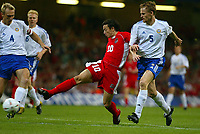 Photograph: Scott Heavey.<br />Wales v Finland. Euro 2004 Qualifier from The Millenium Stadium in Cardiff. 10.09.2003.<br />Simon Davies slots home the opener for Wales.