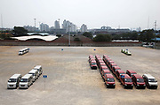 A man walks through a parking lot, almost empty from the high demand, at the SAIC GM Wuling Automobile Co., Ltd factory in Liuzhou, Guangxi Province, China, on August 24, 2009.   The Wuling minivan, popular amongst rural folks and a product of joint venture between General Motors, Shanghai Automotive Industry Corporation, and Liuzhou Wuling Auto, is China's best selling vehicle with over one million sold in 2008.