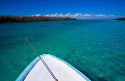 Fishing pole on boat on water in Blackbird Caye, Belize.