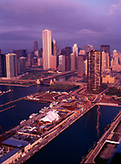 Aerial view of early morning light illuminating the Chicago River and skyscrapers of downtown Chicago, Illinois.