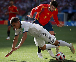 MOSCOW, July 1, 2018  Gerard Pique (R) of Spain vies with Roman Zobnin of Russia during the 2018 FIFA World Cup round of 16 match between Spain and Russia in Moscow, Russia, July 1, 2018. (Credit Image: © Wu Zhuang/Xinhua via ZUMA Wire)