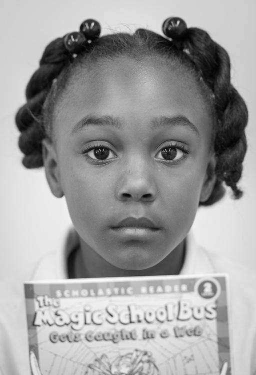 Read Houston Read volunteer Fatima Barnett works with a student at Woodson Elementary School, November 18, 2014.