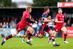 Rhodri Williams of Bristol Rugby is tackled by Scott van Breda (capt) of Jersey Reds - Rogan/JMP - 28/10/2017 - RUGBY UNION - Stade Santander International - St Peter, Jersey - Jersey Reds v Bristol Rugby - Greene King IPA Championship.