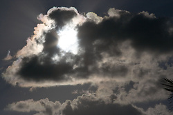 Sun behind a cloud in the Canary Islands,