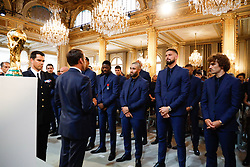 French forward Antoine Griezmann and Antoine Griezmann stand to attention in front of French president Emmanuel Macron during a ceremony to award French 2018 football World Cup winners with the Legion of Honour at the Elysee Palace in Paris, on June 4, 2019. Photo by Hamilton/pool/ABACAPRESS.COM