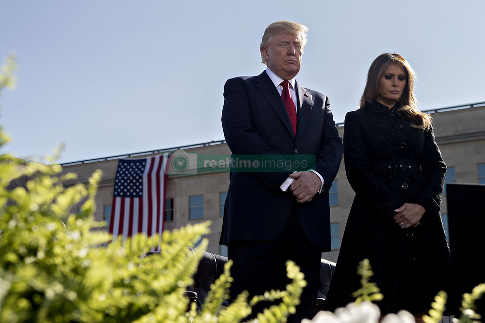 September 11, 2017 - Washington, District of Columbia, U.S. - United States President DONALD J. TRUMP, left, and first lady MELANIA TRUMP pause during a ceremony to commemorate the September 11, 2001 terrorist attacks, at the Pentagon.  (Credit Image: © Andrew Harrer/Pool/CNP via ZUMA Wire)