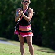 PGA Tour player Brian Gay's wife, Kimberly, follows a round at the Mayakoba Classic in Riviera Maya, Mexico.