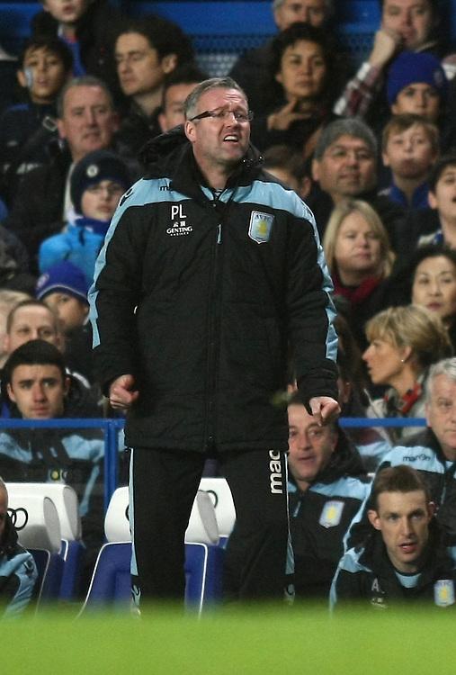 Dejected Aston Villa's Manager Paul Lambert ..Football - Barclays Premiership - Chelsea v Aston Villa - Sunday 23rd December 2012 - Stamford Bridge - London..