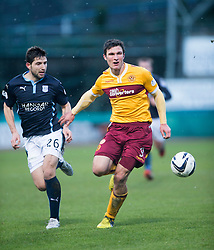 Dundee's Kostadin Gadzhalov and Motherwell's John Sutton. <br /> Dundee 4 v 1 Motherwell, SPFL Premiership played 10/1/2015 at Dundee's home ground Dens Park.