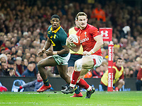 Rugby Union - 2017 Under Armour Series (Autumn Internationals) - Wales vs. South Africa<br /> <br /> Hallam Amos of Wales breaks after he  leaps for the ball from the chip of Rhys Patchell of Wales, at The Principality Stadium (Millennium Stadium), Cardiff.<br /> <br /> COLORSPORT/WINSTON BYNORTH