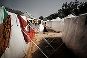 Christian refugee women walk amon the tents of the Tikabali High School campus in Orissa's Kandhamal district, some 350 kms southwest of Bhubaneswar. Nov. 06, 2008.