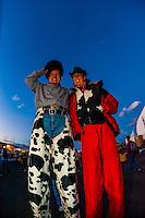 A man and woman on stilts, Balloon FIesta Park during the Albuquerque International Balloon Fiesta, Albuquerque, New Mexico USA.