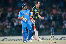 © Licensed to London News Pictures. 28/09/2012. Australian Mitchell Starc celebrates after getting bowling out Indian batsmen Rohit Sharma during the T20 Cricket World cup match between Australia Vs India at the R.Premadasa Cricket Stadium,Colombo. Photo credit : Asanka Brendon Ratnayake/LNP