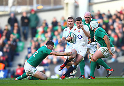 England's George Ford is tackled by Ireland's Robbie Henshaw - Photo mandatory by-line: Ken Sutton/JMP - Mobile: 07966 386802 - 01/03/2015 - SPORT - Rugby - Dublin - Aviva Stadium - Ireland v England - Six Nations