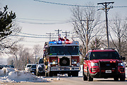 19 DECEMBER 2020 - SAYLOR TOWNSHIP, IOWA: SANTA CLAUS is driven through Saylor Township atop a township firetruck. The Saylor Township Fire Department welcomed Santa Claus to the township on the north edge of Des Moines by showing him around town a fire engine. The event was organized by the Fire Deparment for the town's youngsters who won't be able to see Santa this year because of the Coronavirus pandemic.     PHOTO BY JACK KURTZ