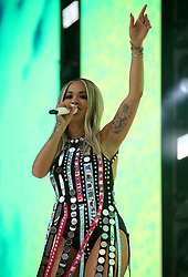 Rita Ora on stage during Capital's Summertime Ball. The world's biggest stars perform live for 80,000 Capital listeners at Wembley Stadium at the UK's biggest summer party.