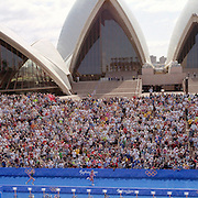 A panoramic image of Brigitte McMahon of Switzerland winning the Women's triathlon gold medal from Michellie Jones, Australia (silver) as they race to the finish line in front of the Sydney Opera House with the Sydney Harbour Bridge providing a stunning backdrop during the  2000 Sydney Olympic Games...Panoramic images from the Sydney Olympic Games, Sydney, Australia. 2000 . Photo Tim Clayton