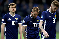 Scotland's Stuart Armstrong (left to right), Johnny Russell and Oliver McBurnie appears dejected after the final whistle during the UEFA Euro 2020 Qualifying, Group I match at the Astana Arena.