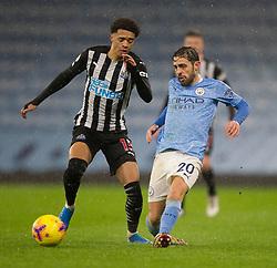 Jamal Lewis of Newcastle United (L) and Bernardo Silva of Manchester City in action - Mandatory by-line: Jack Phillips/JMP - 26/12/2020 - FOOTBALL - Etihad Stadium - Manchester, England - Manchester City v Newcastle United - English Premier League