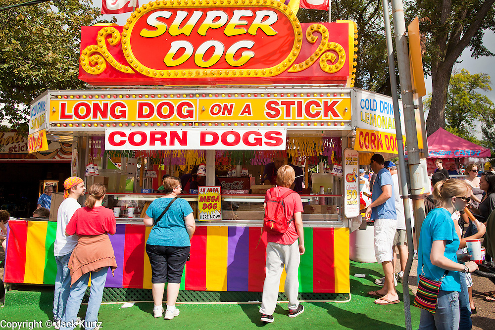 """03 SEPTEMBER 2011 - ST. PAUL, MN: A corn dog stand at the Minnesota State Fair. The Minnesota State Fair is one of the largest state fairs in the United States. It's called """"the Great Minnesota Get Together"""" and includes numerous agricultural exhibits, a vast midway with rides and games, horse shows and rodeos. Nearly two million people a year visit the fair, which is located in St. Paul.   PHOTO BY JACK KURTZ"""