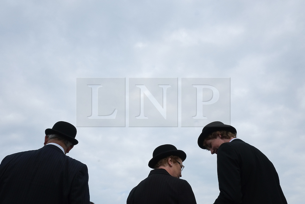 © Licensed to London News Pictures. <br /> 08/07/2014. <br /> <br /> Harrogate, United Kingdom<br /> <br /> Judges chat during the first day of the Great Yorkshire Show. The show is England's Premier Agricultural Event and is based on the 250-acre Great Yorkshire Showground near Harrogate. The Main Ring is the hub of the Show providing a setting for international show jumping and world class cattle parade. The showground is filled with animals, country demonstrations, have-a-go activities and rural crafts.<br /> <br /> Photo credit : Ian Forsyth/LNP