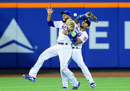 NEW YORK, NY - AUGUST 20:  Dominic Smith #22 and Amed Rosario #1 of the New York Mets collide on a hit by Brandon Crawford of the San Francisco Giants in the 13th innning scoring Andrew McCutchen #22 of the San Francisco Giants on August 20, 2018 at Citi Field in the Flushing neighborhood of the Queens borough of New York City.  (Photo by Elsa/Getty Images)