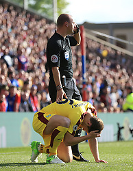 Match referee Bobby Madley checks on the condition of Burnley's James Tarkowski after he was hit on the head by an object thrown from the crowd during the Premier League match at Selhurst Park, London.