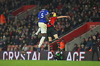 Football - 2018 / 2019 Premier League - Southampton vs. Everton<br /> <br /> Kurt Zouma of Everton and Southampton's Shane Long clash in the air to leave the saints player with a cut on his head at St Mary's Stadium Southampton<br /> <br /> COLORSPORT/SHAUN BOGGUST