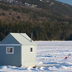A bob house and a pink flamingo on Eagle Lake in Maine's Acadia National Park.  Ice Fishing.