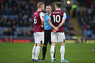 Referee Kevin Friend  has a word with Burnley defender Ben Mee (6) and Burnley forward Ashley Barnes (10) during the Premier League match between Burnley and West Ham United at Turf Moor, Burnley, England on 9 November 2019.