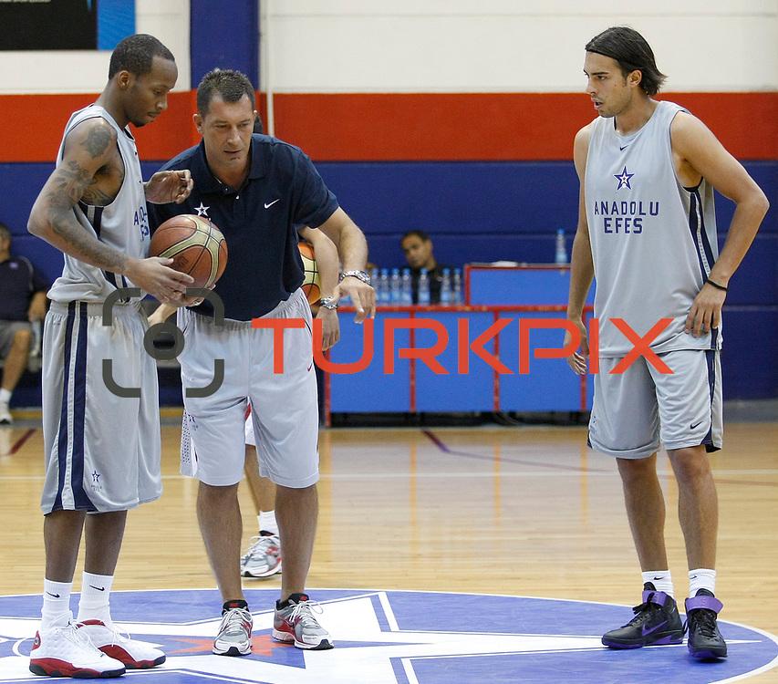 Turkish Basketball team Anadolu Efes's Tarence Kinsey (L), coach Ufuk SARICA (C) and Sasha Vujacic (R) during their new season training at Anadolu Efes sports hall in Istanbul Turkey on Monday 22 August 2011. Photo by TURKPIX