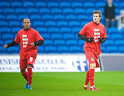 CARDIFF, WALES - Saturday, November 14, 2009: Wales' Aaron Ramsey warms-up wearing a 'Show Racism the Red Card' shirt before the international friendly match against Scotland at the Cardiff City Stadium. (Pic by David Rawcliffe/Propaganda)