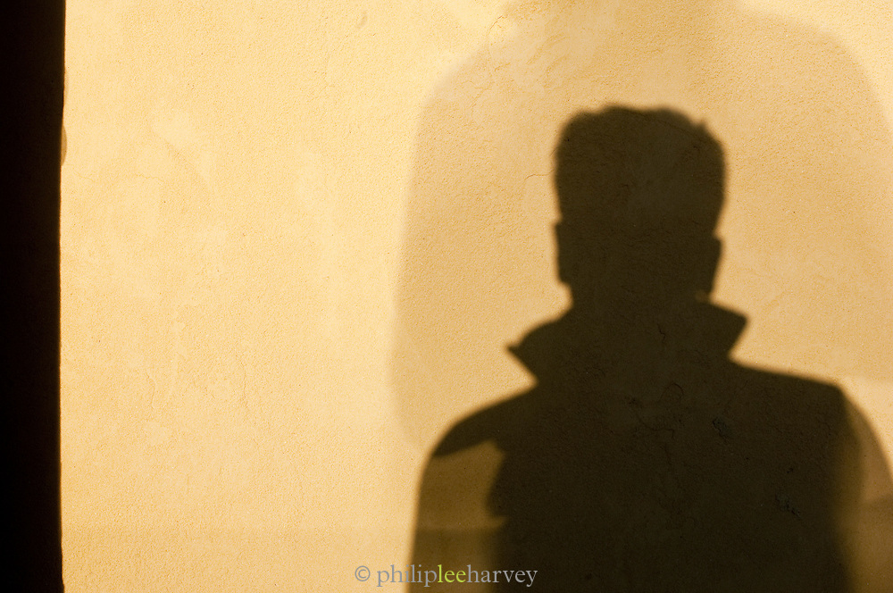 Mans shadow at sunset in the Siwa Oasis, Egypt