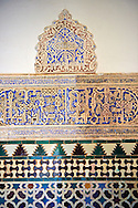 Detail of the Arabesque Mudéjar style plaster work of the Patio de las Doncellas (Courtyard of the Maidens) an Italian Renaissance courtyard (1540-72) , Alcazar of Seville, Seville, Spain . The Royal Alcázars of Seville (al-Qasr al-Muriq ) or Alcázar of Seville, is a royal palace in Seville, Spain. It was built by Castilian Christians on the site of an Abbadid Muslim alcazar, or residential fortress.The fortress was destroyed after the Christian conquest of Seville The palace is a preeminent example of Mudéjar architecture in the Iberian Peninsula but features Gothic, Renaissance and Romanesque design elements from previous stages of construction. The upper storeys of the Alcázar are still occupied by the royal family when they are in Seville. <br /> <br /> Visit our SPAIN HISTORIC PLACES PHOTO COLLECTIONS for more photos to download or buy as wall art prints https://funkystock.photoshelter.com/gallery-collection/Pictures-Images-of-Spain-Spanish-Historical-Archaeology-Sites-Museum-Antiquities/C0000EUVhLC3Nbgw <br /> .<br /> Visit our MEDIEVAL PHOTO COLLECTIONS for more   photos  to download or buy as prints https://funkystock.photoshelter.com/gallery-collection/Medieval-Middle-Ages-Historic-Places-Arcaeological-Sites-Pictures-Images-of/C0000B5ZA54_WD0s