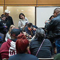 Lyndon Tsosie, 50, center, invites the audience in attendance to get closer as he demonstrates his stamping process at UNM-Gallup Gurley Hall on Wednesday.